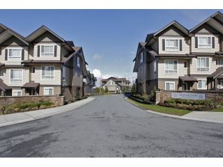 """Photo 1: 20 21867 50 Avenue in Langley: Murrayville Townhouse for sale in """"WINCHESTER"""" : MLS®# R2039227"""