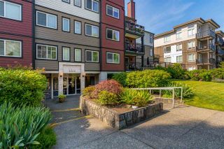"""Photo 1: 206 2344 ATKINS Avenue in Port Coquitlam: Central Pt Coquitlam Condo for sale in """"River Edge"""" : MLS®# R2478252"""