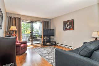 "Photo 1: 102 17661 58A Avenue in Surrey: Cloverdale BC Condo for sale in ""Wyndham Estates"" (Cloverdale)  : MLS®# R2483711"