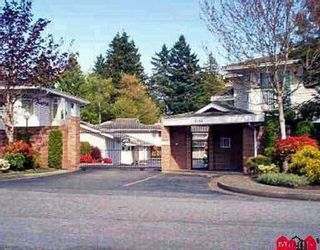 """Photo 1: 204 10584 153RD Street in Surrey: Guildford Townhouse for sale in """"GLENWOOD VILLAGE ON THE PARK"""" (North Surrey)  : MLS®# F1004979"""
