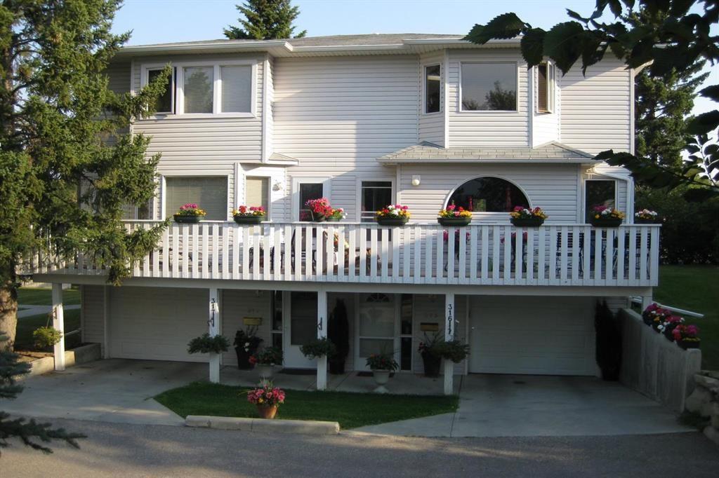 Main Photo: 317 Killarney Glen Court SW in Calgary: Killarney/Glengarry Row/Townhouse for sale : MLS®# A1144088