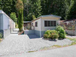 """Photo 1: 7 12248 SUNSHINE COAST Highway in Madeira Park: Pender Harbour Egmont Manufactured Home for sale in """"SEVEN ISLES"""" (Sunshine Coast)  : MLS®# R2604086"""