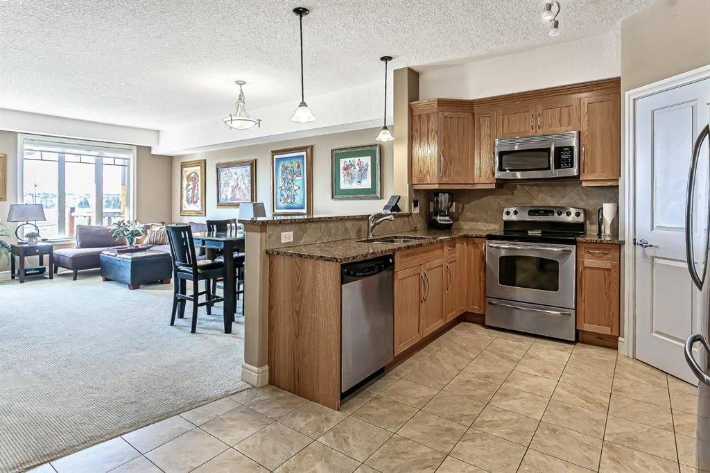 Photo 9: Photos: 1445 2330 FISH CREEK Boulevard SW in Calgary: Evergreen Apartment for sale : MLS®# A1082704