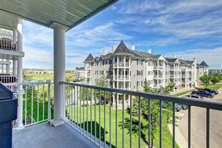 Photo 2: 2311 43 COUNTRY VILLAGE Lane NE in Calgary: Country Hills Village Apartment for sale : MLS®# A1031045
