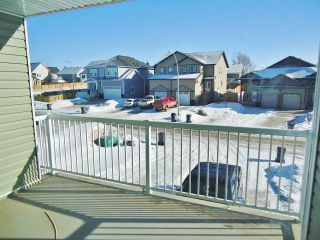 """Photo 11: 10412 109 Street in Fort St. John: Fort St. John - City NW 1/2 Duplex for sale in """"SUNSET RIDGE"""" (Fort St. John (Zone 60))  : MLS®# R2415787"""