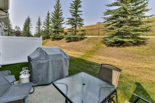 Photo 30: 93 Rocky Vista Circle NW in Calgary: Rocky Ridge Row/Townhouse for sale : MLS®# A1071802