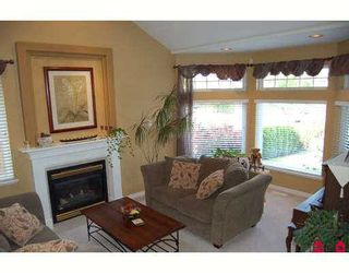 """Photo 2: 6828 181ST Street in Surrey: Cloverdale BC House for sale in """"Cloverwoods"""" (Cloverdale)  : MLS®# F2711956"""