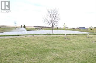 Photo 3: 1003 Spring Street in Coaldale: Condo for sale : MLS®# A1112773