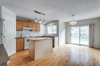 Photo 15: 7854 Springbank Way SW in Calgary: Springbank Hill Detached for sale : MLS®# A1142392