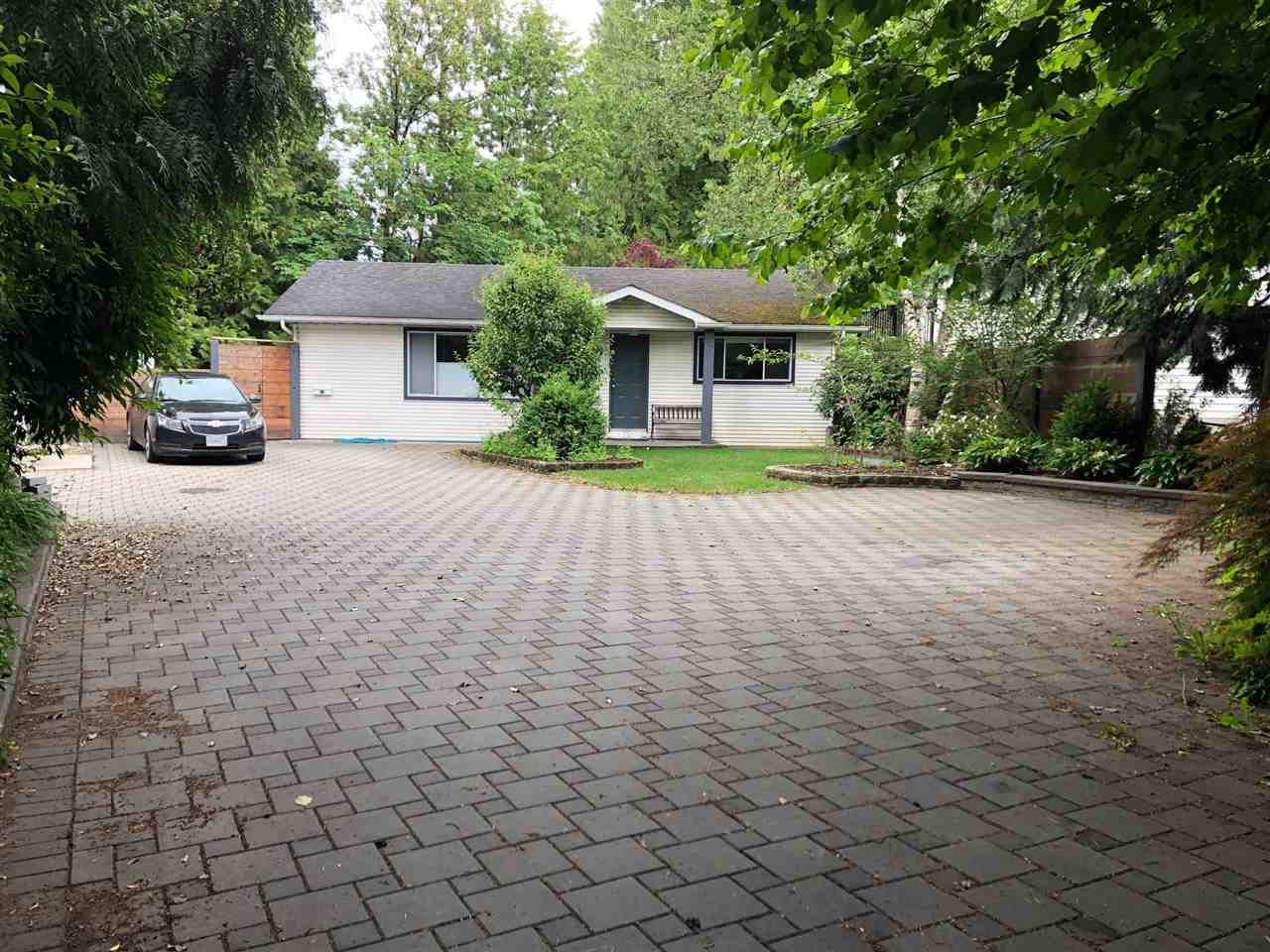 Main Photo: 4930 200 Street in Langley: Langley City House for sale : MLS®# R2591666