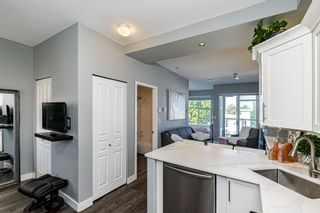 """Photo 20: #407 20200 56 Avenue in Langley: Langley City Condo for sale in """"The Bentley"""" : MLS®# R2598723"""