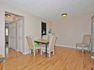 Photo 2: 10 73 GLENBROOK Crescent: Cochrane House for sale : MLS®# C4004769