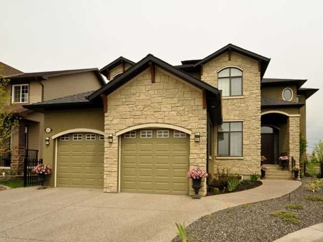 Acrylic Stucco  with extensive stone, expossed agragate driveway, walks and steps