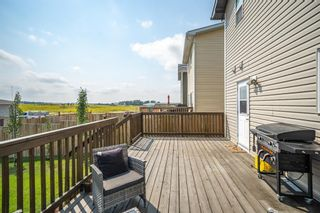 Photo 33: 72 Mackenzie Way: Carstairs Detached for sale : MLS®# A1132574