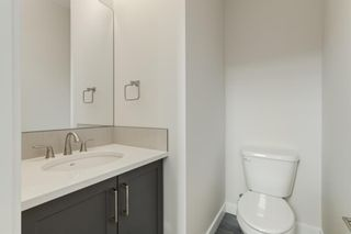 Photo 17: 231 81 Greenbriar Place NW in Calgary: Greenwood/Greenbriar Row/Townhouse for sale : MLS®# A1104462
