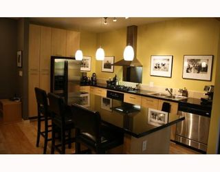 """Photo 1: 202 560 RAVEN WOODS Drive in North_Vancouver: Roche Point Condo for sale in """"SEASONS WEST"""" (North Vancouver)  : MLS®# V654225"""