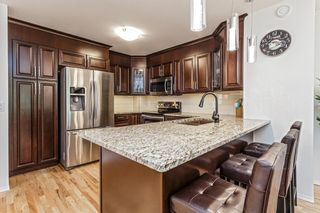 Photo 6: 1 2015 24 Street SW in Calgary: Richmond Row/Townhouse for sale : MLS®# A1125834