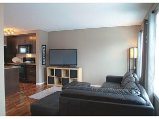 Photo 7: 418 WALDEN Drive SE in Calgary: Walden House for sale : MLS®# C3649474