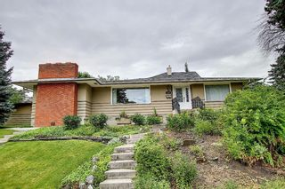 Main Photo: 1207 Kingston Street NW in Calgary: St Andrews Heights Detached for sale : MLS®# A1140823