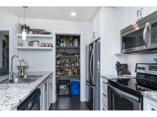 """Photo 10: 205 2242 WHATCOM Road in Abbotsford: Abbotsford East Condo for sale in """"WATERLEAF"""" : MLS®# R2455089"""