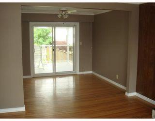 Photo 7: 2165 CENTENNIAL Avenue in Port_Coquitlam: Glenwood PQ House for sale (Port Coquitlam)  : MLS®# V776626