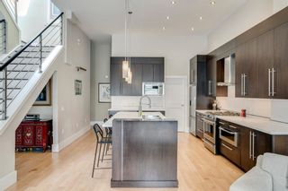 Photo 7: 100 18 Avenue SE in Calgary: Mission Row/Townhouse for sale : MLS®# A1100251