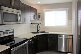 Photo 12: 1404 Clover Link: Carstairs Row/Townhouse for sale : MLS®# A1073804