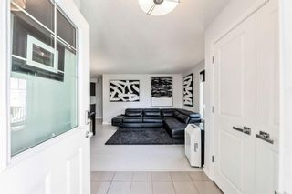 Photo 2: 605 250 Sage Valley Road in Calgary: Sage Hill Row/Townhouse for sale : MLS®# A1147689