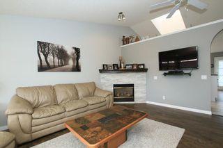 Photo 9: 306 WEST TERRACE Place: Cochrane House for sale : MLS®# C4117766