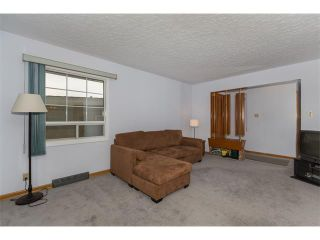 Photo 9: 1011 THORNEYCROFT Drive NW in Calgary: Thorncliffe House for sale : MLS®# C4026935