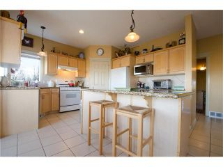 Photo 8: 76 STRATHLEA Place SW in Calgary: Strathcona Park House for sale : MLS®# C4092293