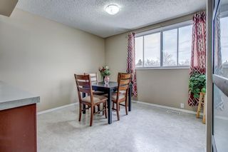 Photo 10: 1309 Ranchlands Road NW in Calgary: Ranchlands Row/Townhouse for sale : MLS®# A1060522