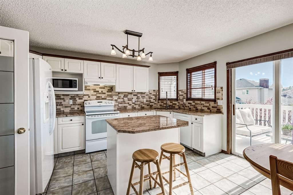 Main Photo: 34 Arbour Crest Close NW in Calgary: Arbour Lake Detached for sale : MLS®# A1116098