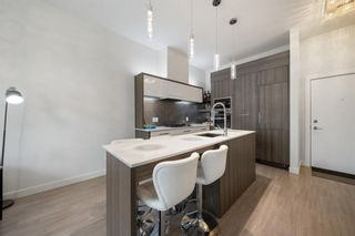 Photo 3: 103 119 19 Street NW in Calgary: West Hillhurst Apartment for sale : MLS®# A1116519
