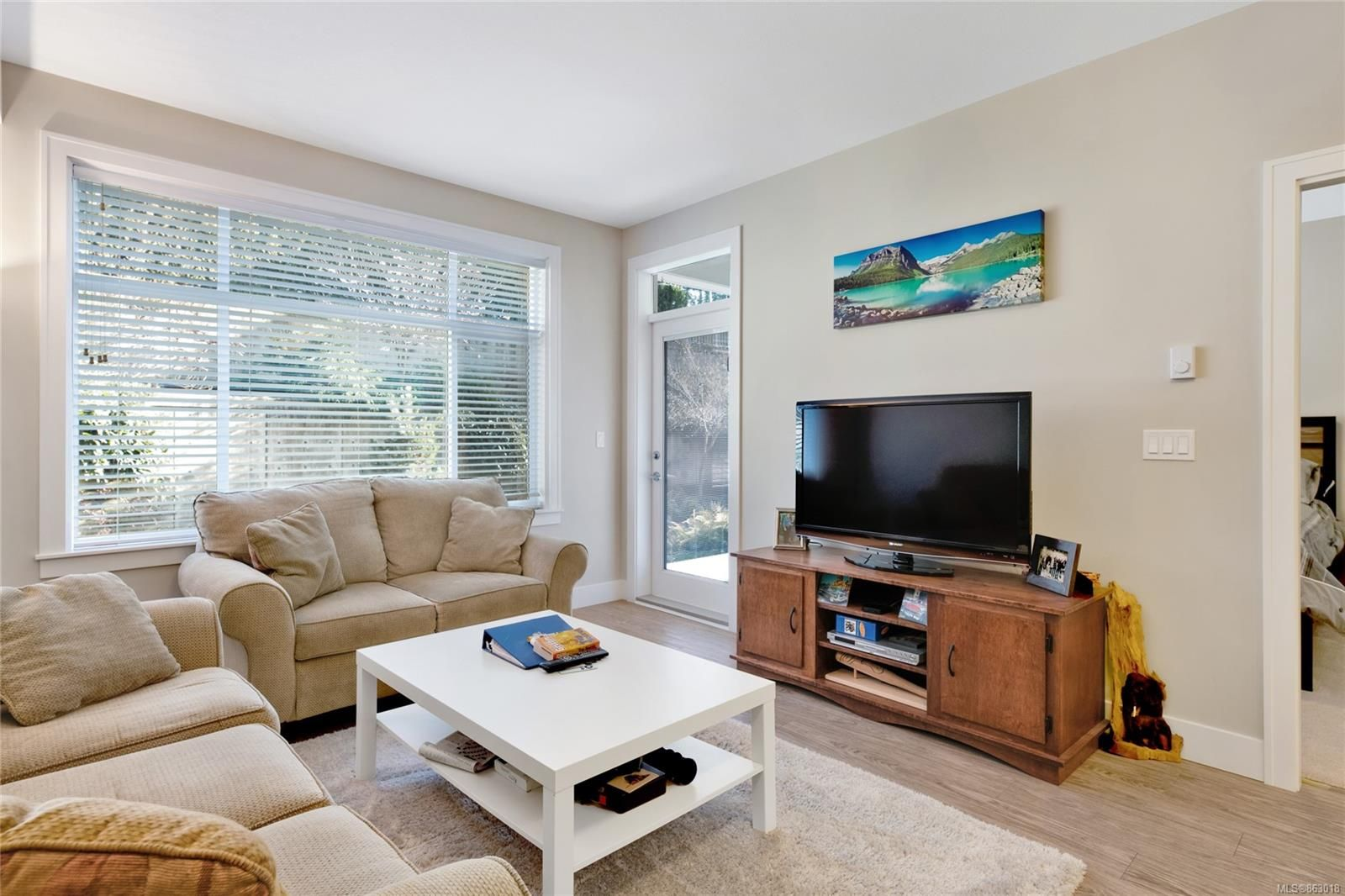 Main Photo: 113 4960 Songbird Pl in : Na Uplands Condo for sale (Nanaimo)  : MLS®# 863018
