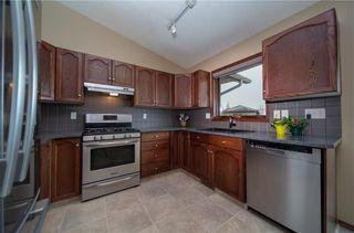 Photo 6: 77 WEST EDGE Road: Cochrane House for sale : MLS®# C4177581