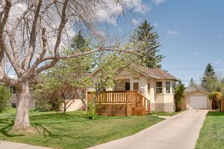 Photo 1: 3118 39 Street SW in Calgary: Glenbrook Detached for sale : MLS®# A1105435