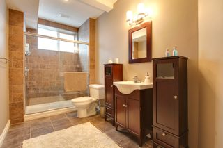 Photo 17: 131 Cougar Plateau Circle SW in Calgary: 2 Storey for sale : MLS®# C3614218