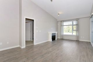"Photo 2: 305 23285 BILLY BROWN Road in Langley: Fort Langley Condo for sale in ""The Village at Bedford Landing"" : MLS®# R2211106"