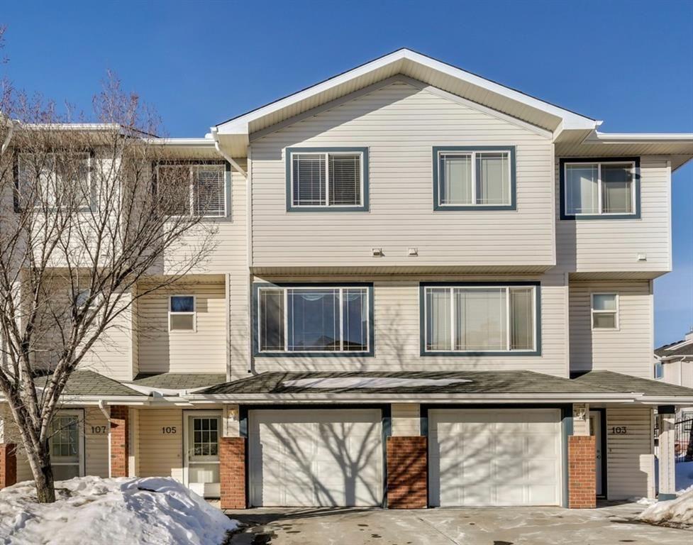 Main Photo: 105 Rocky Ridge Court NW in Calgary: Rocky Ridge Row/Townhouse for sale : MLS®# A1069587