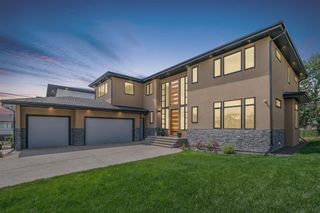 Photo 1: 40 Elveden Bay SW in Calgary: Springbank Hill Detached for sale : MLS®# A1129448