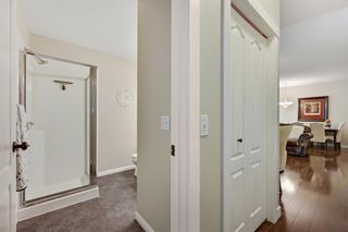 Photo 23: 1004 1997 Sirocco Drive SW in Calgary: Signal Hill Row/Townhouse for sale : MLS®# A1132991