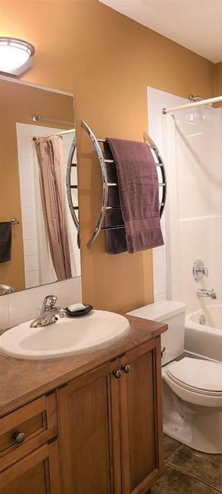 Photo 14: 106 248 Sunterra Ridge Place: Cochrane Apartment for sale : MLS®# A1097518