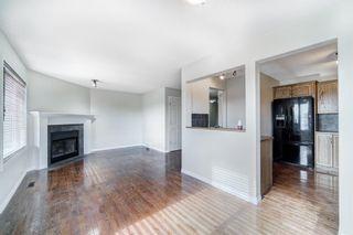 Photo 10: 4 136 Bow Ridge Drive: Cochrane Row/Townhouse for sale : MLS®# A1116097