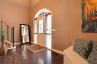 Photo 3: 131 Cougar Plateau Circle SW in Calgary: 2 Storey for sale : MLS®# C3614218