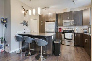Photo 2: 705 10 Auburn Bay Avenue SE in Calgary: Auburn Bay Row/Townhouse for sale : MLS®# A1046480
