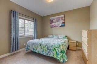 Photo 19: 1401 281 COUGAR RIDGE Drive SW in Calgary: Cougar Ridge Row/Townhouse for sale : MLS®# A1070231