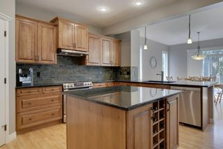 Photo 13: 145 TREMBLANT Place SW in Calgary: Springbank Hill Detached for sale : MLS®# A1024099