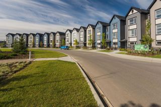 Photo 2: 406 16 Evanscrest Park NW in Calgary: Evanston Row/Townhouse for sale : MLS®# A1130308
