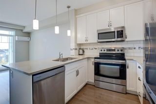 Photo 3: 410 406 Cranberry Park SE in Calgary: Cranston Apartment for sale : MLS®# A1148440
